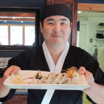 Danny Chang with sushi