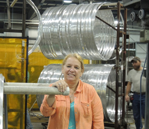 """The new """"lean initiative"""" is already producing significant improvements in efficiency and productivity, said Telescope Casual Furniture CEO Kathy Juckett. Behind her are table rims that have been bent into circles and are waiting for the next step in production."""
