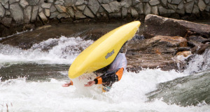 A kayaker does a flip in the Nantahala River, North Carolina. The McLaughlin Whitewater Design Group created the wave-making park and has designed the Sacandaga Whitewater Park. McLaughlin Whitewater Design Group photo