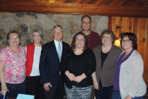 At last week's party at the Long Horn Restaurant in Lake Luzerne — The honoree Stan Rummel is third from the left. Also in the photo, from left: Mr. Rummel's wife Susan; his daughter Holly Rummel-Jackson, Karen Cormie, Frank Troelstra, Becky (Addison) Troelstra and Donna Slack. Chronicle photo/Gordon Woodworth