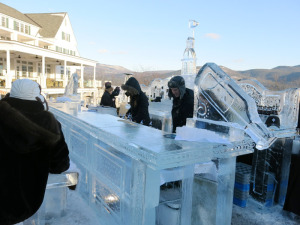 An ice 'luge' — Bartenders pour alcohol through a channel in the bottle-shaped sculpture, to create chilled shots. Chronicle photo/Mark Frost