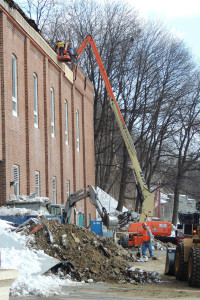A Rozell Industries crew works to seal up the portion of the back wall of the Glens Falls Civic Center on Monday, March 8. Chronicle photo/Gordon Woodworth