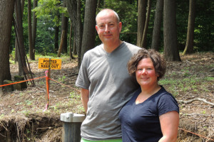 """Steve & Jennifer Kitchen on their Assembly Point lot in the summer of 2013 — in front of the well they had drilled, and the """"No Trespassing"""" sign at the edge of George Hearst's property. The state's second highest court last week rejected the latest attempt to block the Kitchens from building a summer home. They said construction will begin soon.  Chronicle photo/Gordon Woodworth"""