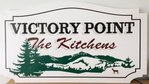 Some neighbors who supported Steven and Jennifer Kitchen had this sign made after New York's Appellate Division unanimously rejected an appeal that would have stopped the Kitchens' from building a small second home on Assembly Point.