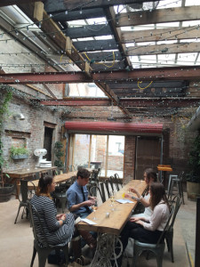 The Garden in-between The Confectionery and Peck's Arcade is a year-round space. Here, in cool weather, the clear roof was still on and the space heated. In warm weather, the roof is off.