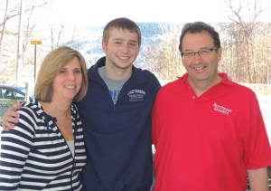 Joel Wincowski with his parents Carol and Joel, at their Lake George home. Chronicle photo/Gordon Woodworth