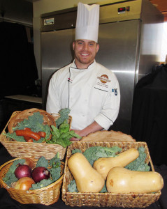 Dunham's Bay Chef AJ Richards, in his kitchen with local vegetables. Chronicle photo/David Cederstrom
