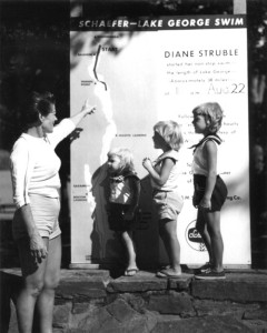 Publicity shot — Amanda Struble (Diane's mother), tracks Diane's progress with the swimmer's daughters Debbie (2), Sylvia Gwenne (4) and Stephanie (5). Note the Schaefer beer logo on the poster.