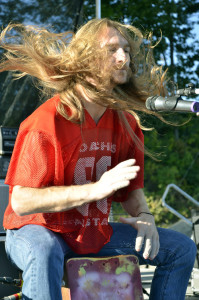 Kris Bentley, long-locked outlaw country duo member on the cajón drum, was half-Pantene commercial, half-Animal, the Muppets' drummer. Chronicle photo/Cathy DeDe