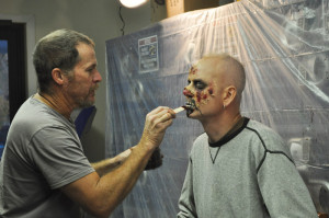Make-up artist Phil Singer, in the process of transforming Jason Irwin.