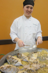 African-inspired dinner was served by aspiring chef John Lam, of the SUNY Adirondack Culinary Arts program. The buffet, based on cuisine of Sierra Leone, on the east coast of Africa, included this Poisson Braise, fresh fish off the bone, with braised onions and lemon thyme. Cathy DeDe photo