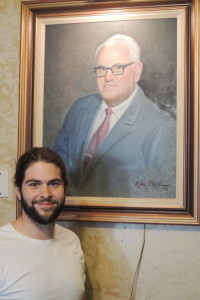 """New Massie's owner Jonathan Greenwood, in front of a painting of Ralph """"Massie"""" Russo, who ran the restaurant for more than 60 years until his death in 1992.              Chronicle photo/Gordon Woodworth"""