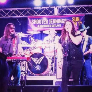 Katy Cole joined Waymore's Outlaws on stage, earlier this month at a club in Warrendale, Pennsylvania. Frontman Shooter Jennings — Waylon's son — is far left. Ms. Cole is featured on his newest album.