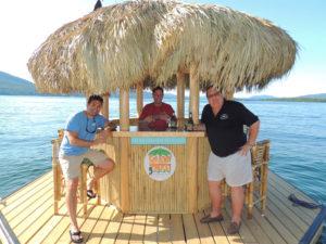 Enjoying their floating Tiki bar, from left, Greg Teresi, Frank Casimo and Larry Davis. Chronicle photos/Gordon Woodworth