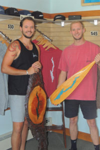 "Domenick Pfau, left, and Matt Peterson, in their ""Local"" store in Bolton Landing with some of their  merchandise featuring a silhouette of Lake George. Chronicle photo/Gordon Woodworth"