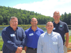 At last week's Lake George Land Conservancy annual meeting at the Bolton Conservation Club, from left, Jeff Killeen, board chairman of the FUND for Lake George, Dave Wick, executive director of the Lake George Park Commission, Jamie Brown, executive director of the Lake George Land Conservancy and Walt Lender, executive director of the Lake George Association.  Chronicle photo/Gordon Woodworth