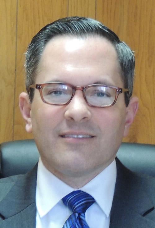 Ryan Moore as Warren County Administrator winning praise